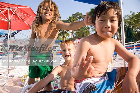Multi-ethnic boys at water park in summer Stock Photo - Rights-Managed, Image code: 842-03200260