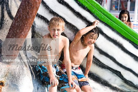 Two boys getting wet at water park in summer Stock Photo - Rights-Managed, Image code: 842-03200301