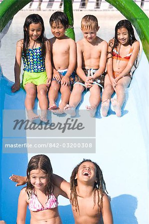Multi-ethnic children on slide at water park in summer Stock Photo - Rights-Managed, Image code: 842-03200308