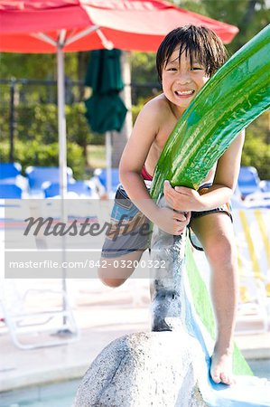Young Asian boy playing at water park in summer Stock Photo - Rights-Managed, Image code: 842-03200322
