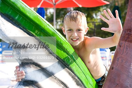 Young blonde boy waving at water park in summer Stock Photo - Rights-Managed, Image code: 842-03200323