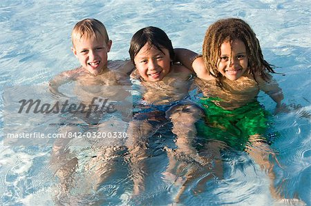 Multi-ethnic boys in swimming pool Stock Photo - Rights-Managed, Image code: 842-03200330