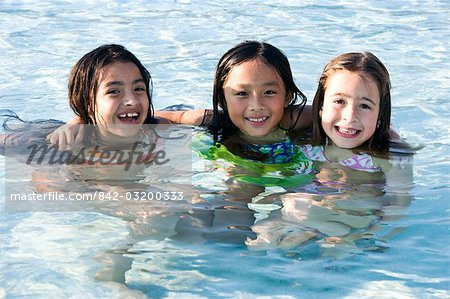 Three happy young girls in swimming pool Stock Photo - Rights-Managed, Image code: 842-03200333