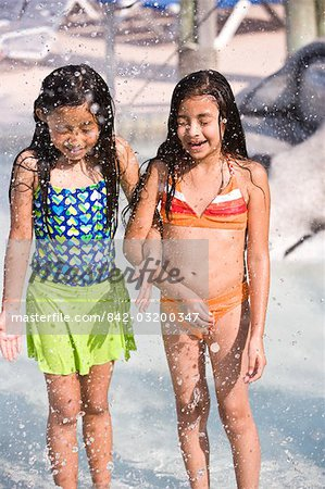 Two young girls arm in arm at water park Stock Photo - Rights-Managed, Image code: 842-03200347