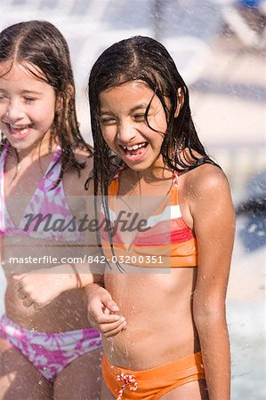 Two young girls arm in arm at water park Stock Photo - Rights-Managed, Image code: 842-03200351