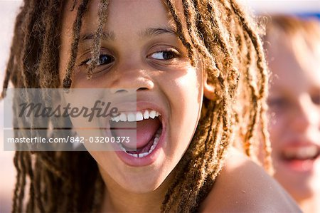 Close-up of happy young African American boy grinning on pool deck Stock Photo - Rights-Managed, Image code: 842-03200373