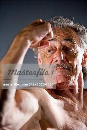 Senior man flexing muscles, studio shot Stock Photo - Rights-Managed, Image code: 842-03200683
