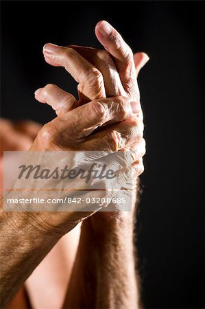 Close-up of senior man rubbing his sore hand Stock Photo - Rights-Managed, Image code: 842-03200685