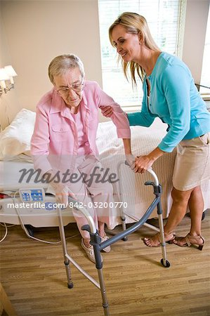 Adult daughter helping elderly mother use walker Stock Photo - Rights-Managed, Image code: 842-03200770