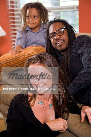 Mixed race family sitting on couch in living room Stock Photo - Rights-Managed, Image code: 842-03200857