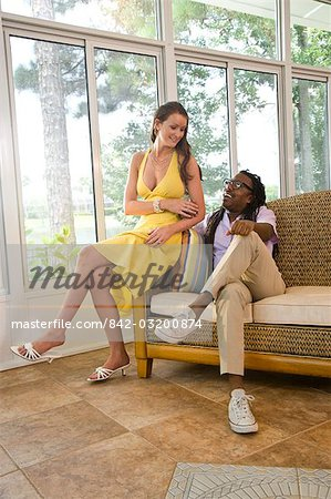 Portrait of mixed race couple relaxing in sunroom Stock Photo - Rights-Managed, Image code: 842-03200874
