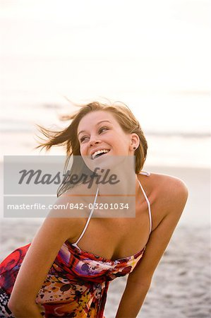 Young happy woman in colorful sundress standing on beach Stock Photo - Rights-Managed, Image code: 842-03201034