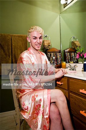 Drag queen in robe sitting in bathroom Stock Photo - Rights-Managed, Image code: 842-05979284