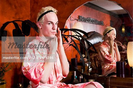 Drag queen sitting at vanity getting ready Stock Photo - Rights-Managed, Image code: 842-05979286