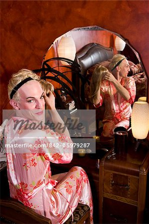 Drag queen putting on wig Stock Photo - Rights-Managed, Image code: 842-05979287
