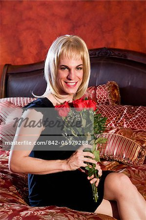 Drag queen holding red roses Stock Photo - Rights-Managed, Image code: 842-05979288