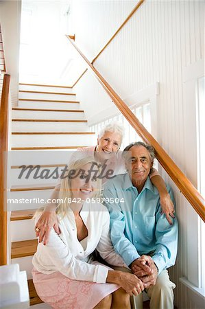 Portrait of adult daughter with senior parents sitting on staircase Stock Photo - Rights-Managed, Image code: 842-05979504