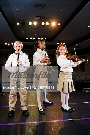 Young students playing musical instruments in school auditorium Stock Photo - Rights-Managed, Image code: 842-05979896