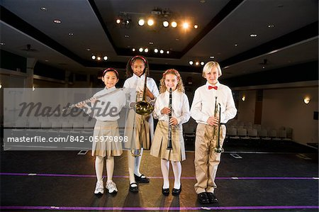 Young students playing musical instruments in school auditorium Stock Photo - Rights-Managed, Image code: 842-05979898