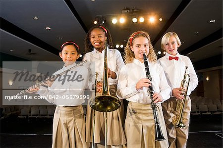 Young students playing musical instruments in school auditorium Stock Photo - Rights-Managed, Image code: 842-05979899