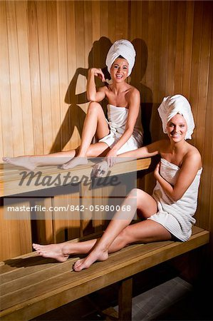 Young women relaxing in sauna wrapped in towels Stock Photo - Rights-Managed, Image code: 842-05980068