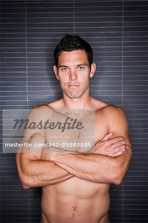 Muscular shirtless man with arms folded Stock Photo - Rights-Managed, Image code: 842-05980085