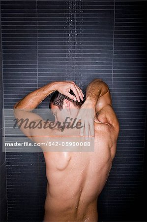 Back of man taking a shower Stock Photo - Rights-Managed, Image code: 842-05980088