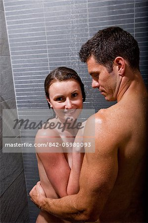 Romantic couple taking a shower Stock Photo - Rights-Managed, Image code: 842-05980093