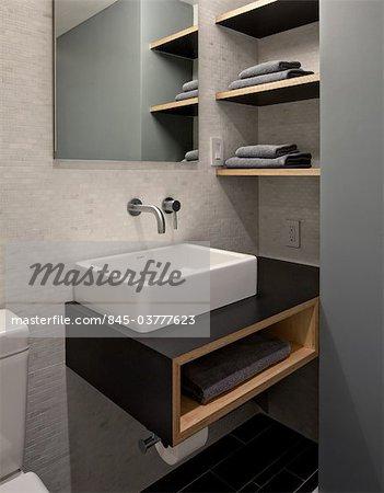 bathroom with toilet  modern rectangular washbasin and storage shelves  Architects  WE Design   Winston Ely   Stock Photo. bathroom with toilet  modern rectangular washbasin and storage