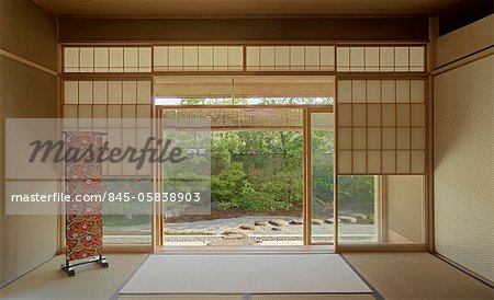 Traditionally Japanese sparsely furnished room with view through sliding doors to garden Stock Photo - Rights-Managed, Image code: 845-05838903
