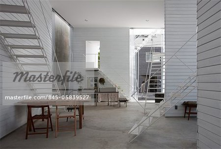Yokohama Apartment, Apartment house, View of the dining and kitchen area on the ground floor, looking towards the west. Architects: Osamu Nishida + Erika Nakagawa, ON Design Stock Photo - Rights-Managed, Image code: 845-05839527
