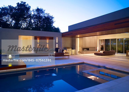 Swimming pool area with view into living room of Menlo Park Residence, USA. Stock Photo - Rights-Managed, Image code: 845-07561391