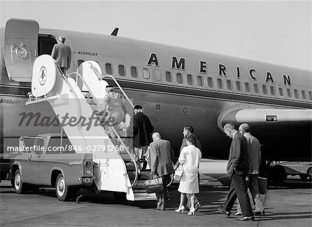 1960s PASSENGERS BOARDING AMERICAN AIRLINES ASTROJET BY WAY OF SHORT STAIRWAY RAISED FROM BED OF PICKUP TRUCK Stock Photo - Rights-Managed, Image code: 846-02791760