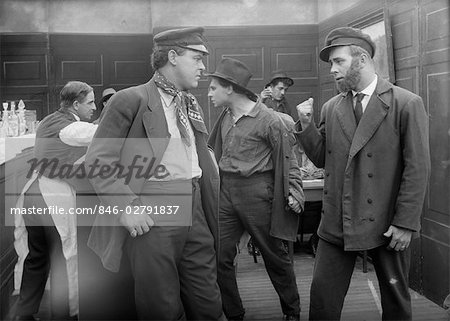 MEN IN WESTERN SALOON ABOUT TO ENGAGE IN BAR FIGHT Stock Photo - Rights-Managed, Image code: 846-02791837