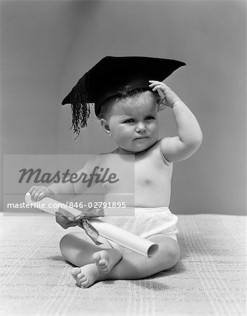 1940s BABY WEARING MORTAR BOARD GRADUATION CAP AND HOLDING DIPLOMA