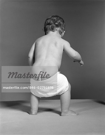1940s 1950s 1960s BABY WITH DROOPY DIAPER FALLING DOWN SHOWING NUDE BOTTOM BUTT Stock Photo - Rights-Managed, Image code: 846-02791978