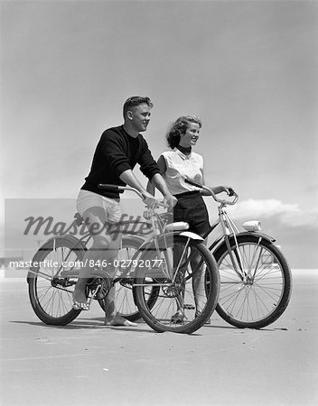 1950s TEENAGE BOY AND GIRL WITH BIKES ON THE BEACH Stock Photo - Rights-Managed, Image code: 846-02792077