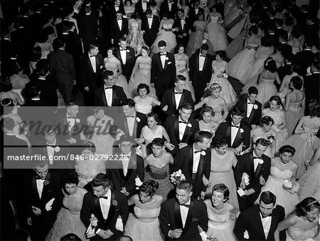 1950s GRAND MARCH AT HIGH SCHOOL PROM DANCE PROMENADE TEEN COUPLES FORMAL DRESS Stock Photo - Rights-Managed, Image code: 846-02792225