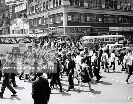 1960s CROWD CROSSING BUSY INTERSECTION IN NEW YORK CITY WITH BUS & CAB IN BACKGROUND Stock Photo - Rights-Managed, Image code: 846-02792314