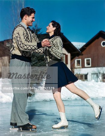 1940s 1950s SMILING COUPLE ICE SKATING Stock Photo - Rights-Managed, Image code: 846-02792329