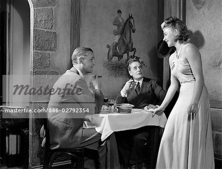 1930s 1940s 2 MEN EATING CLUB RESTAURANT 1 WOMAN FLIRTING TABLE BLOND WOMAN SMOKING CIGAR CIGARS Stock Photo - Rights-Managed, Image code: 846-02792354
