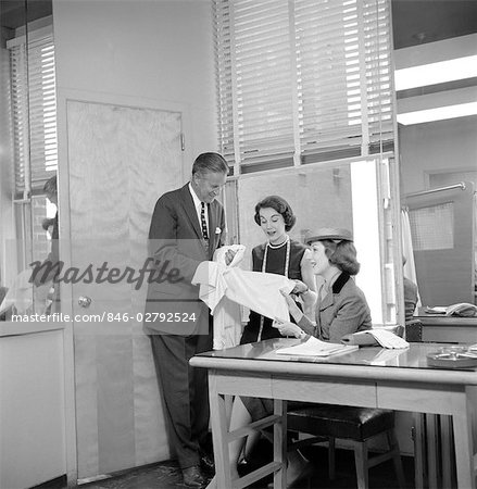 1950s FEMALE FASHION BUYER SELECTING FABRIC IN GARMENT INDUSTRY SHOWROOM Stock Photo - Rights-Managed, Image code: 846-02792524