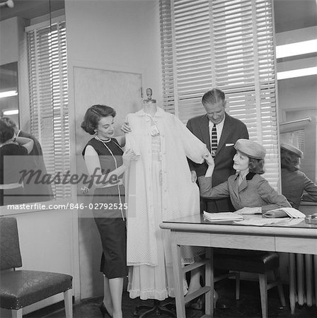 1950s FEMALE RETAIL FASHION BUYER SELECTING SAMPLE LINGERIE IN GARMENT INDUSTRY SHOWROOM Stock Photo - Rights-Managed, Image code: 846-02792525