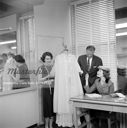 1950s FEMALE FASHION BUYER SELECTING LINGERIE CLOTHING IN A GARMENT INDUSTRY SHOWROOM Stock Photo - Rights-Managed, Image code: 846-02792526