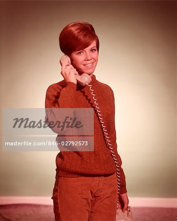 1960s WOMAN TALKING ON TELEPHONE LOOKING AT CAMERA Stock Photo - Rights-Managed, Image code: 846-02792573