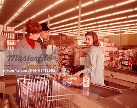 1960s COUPLE AT CHECK OUT COUNTER OF SUPERMARKET Stock Photo - Rights-Managed, Image code: 846-02792592