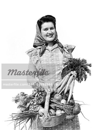 1940s WOMAN PORTRAIT AT CAMERA CARRYING BASKET FULL OF GARDEN VEGETABLES Stock Photo - Rights-Managed, Image code: 846-02792946