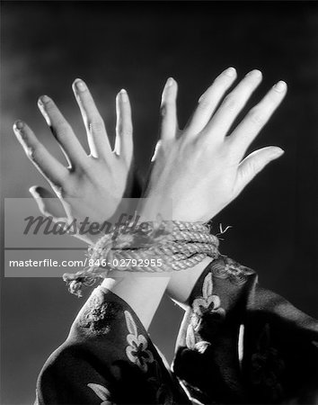 1930s WOMAN'S HANDS TIED TOGETHER BY ROPE OVERHEAD VIEW
