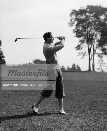 1930s GOLFER IN KNICKERS WITH CLUB IN AIR Stock Photo - Rights-Managed, Image code: 846-02793015