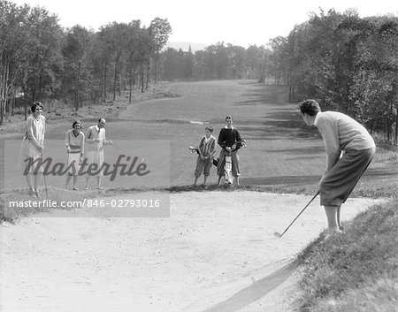 1930s MAN IN KNICKERS GOLFING IN SAND TRAP WITH MEN & WOMEN LOOKING ON Stock Photo - Rights-Managed, Image code: 846-02793016